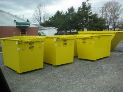 Several commercial waste containers